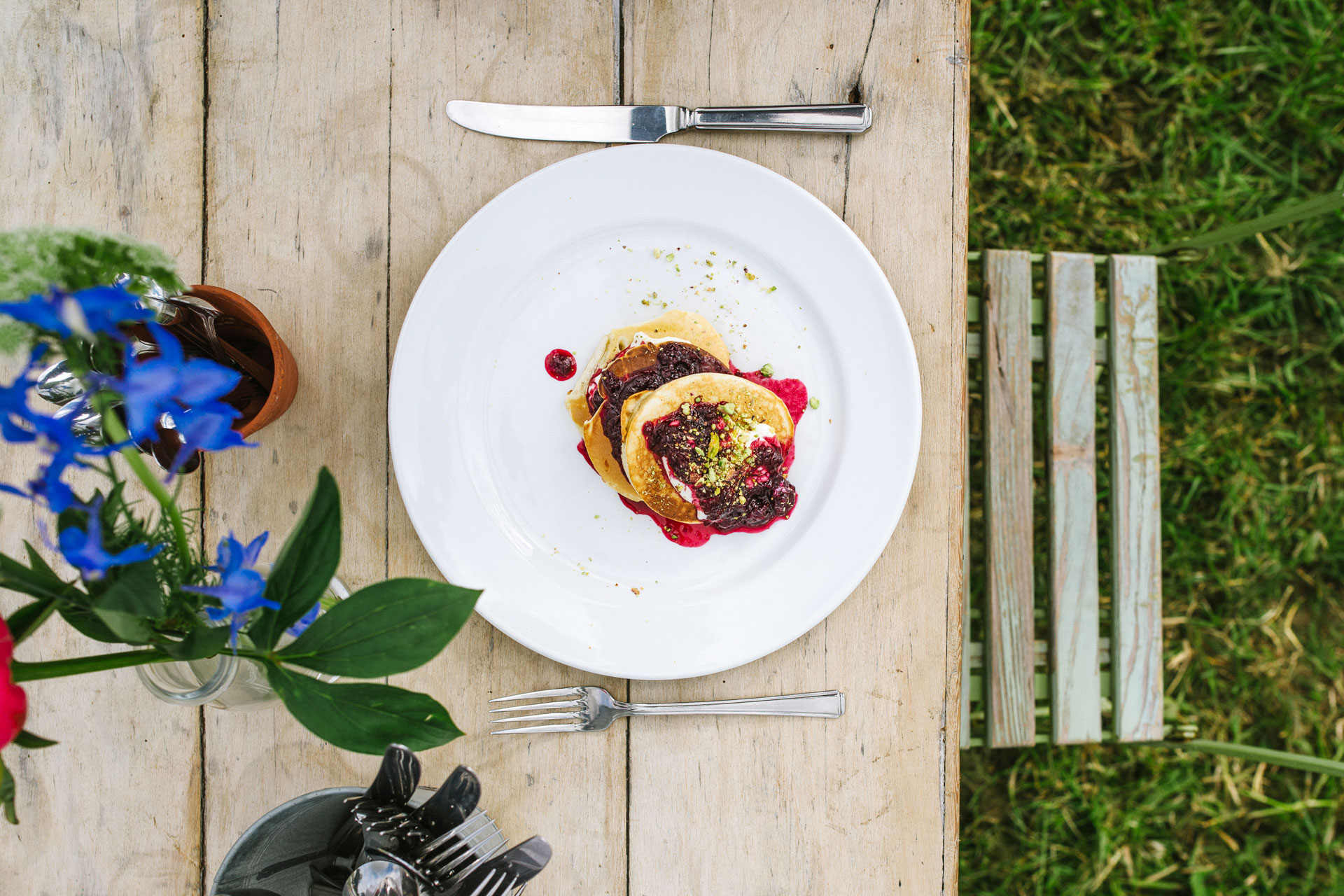 Stacked American Pancakes with cherry compote and vanilla labneh