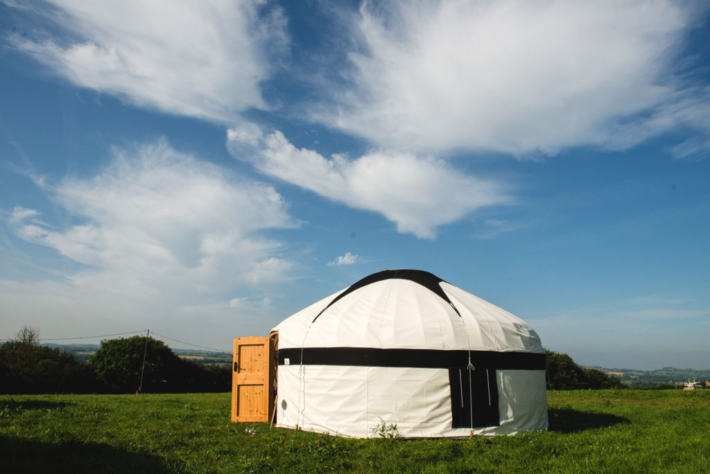Large yurt in white and black canvas at Pennard Orchard Boutique Camping
