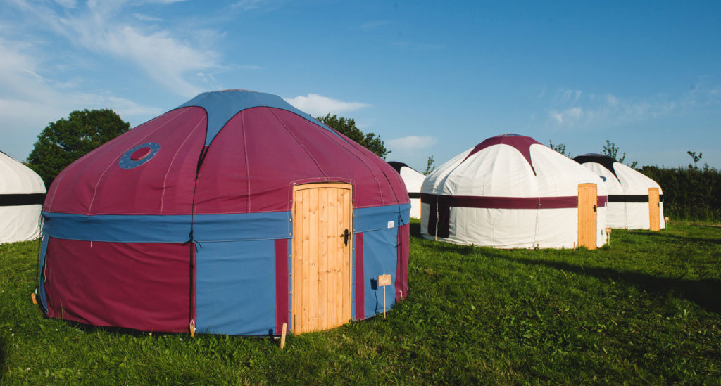 Large yurts at Pennard Orchard during Glastonbury Festival