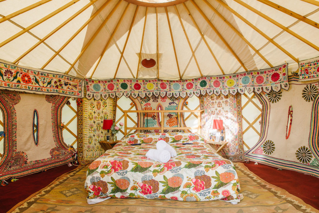 Beautiful wall hangings in the luxury yurts at Pennard Orchard Glastonbury Boutique Camping