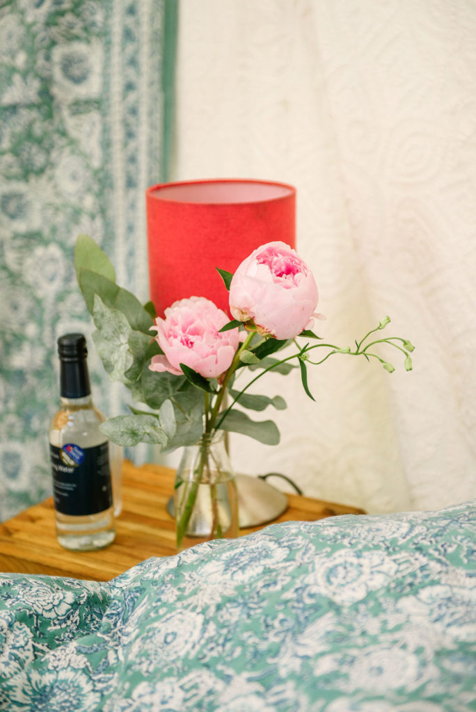 Peonies in a luxury yurt at Pennard Orchard Boutique Camping Glastonbury