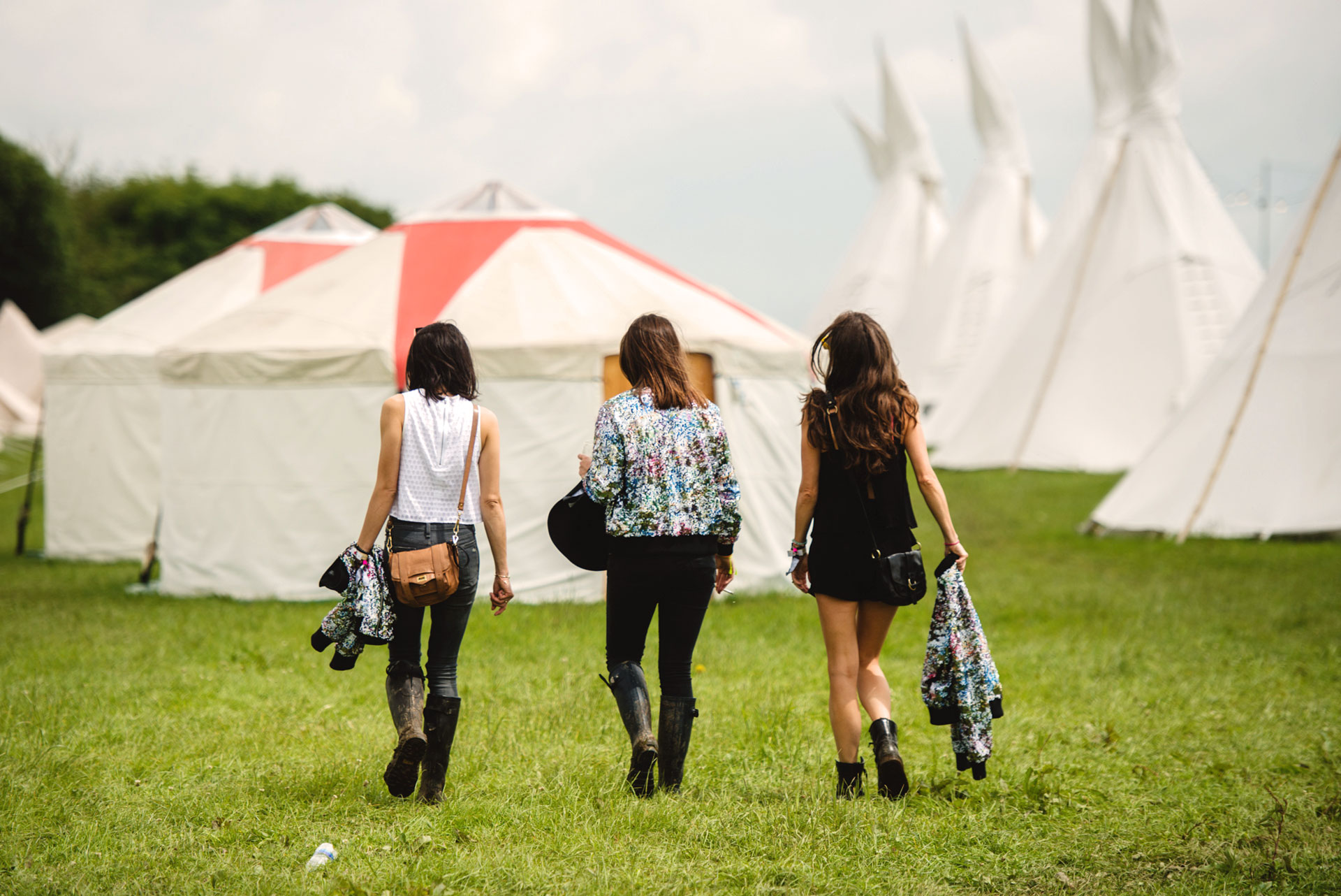 Guests walking to their luxury yurt accommodation at Pennard Orchard for Glastonbury Festival