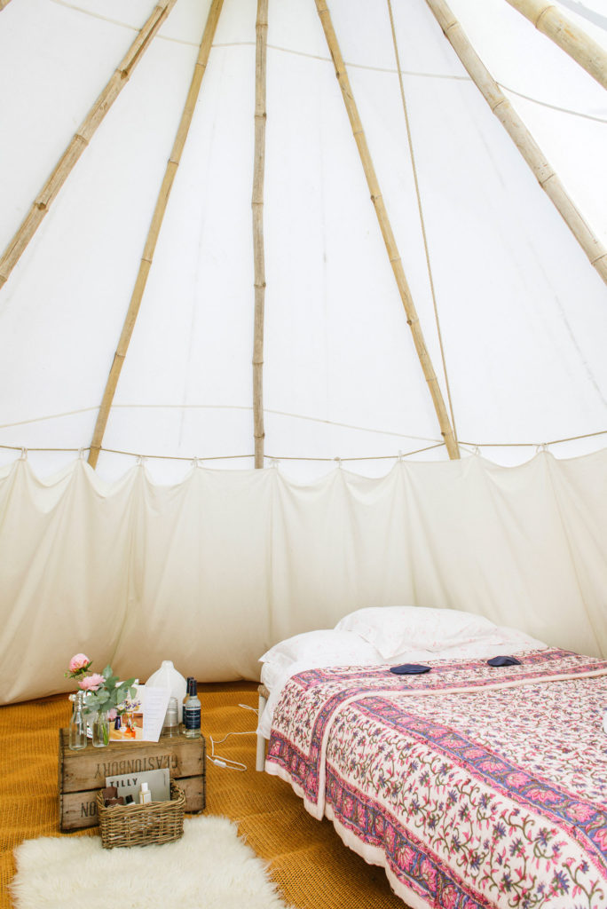 towering poles in our majestic tipis at Pennard Orchard Boutique Camping for Glastonbury Festival