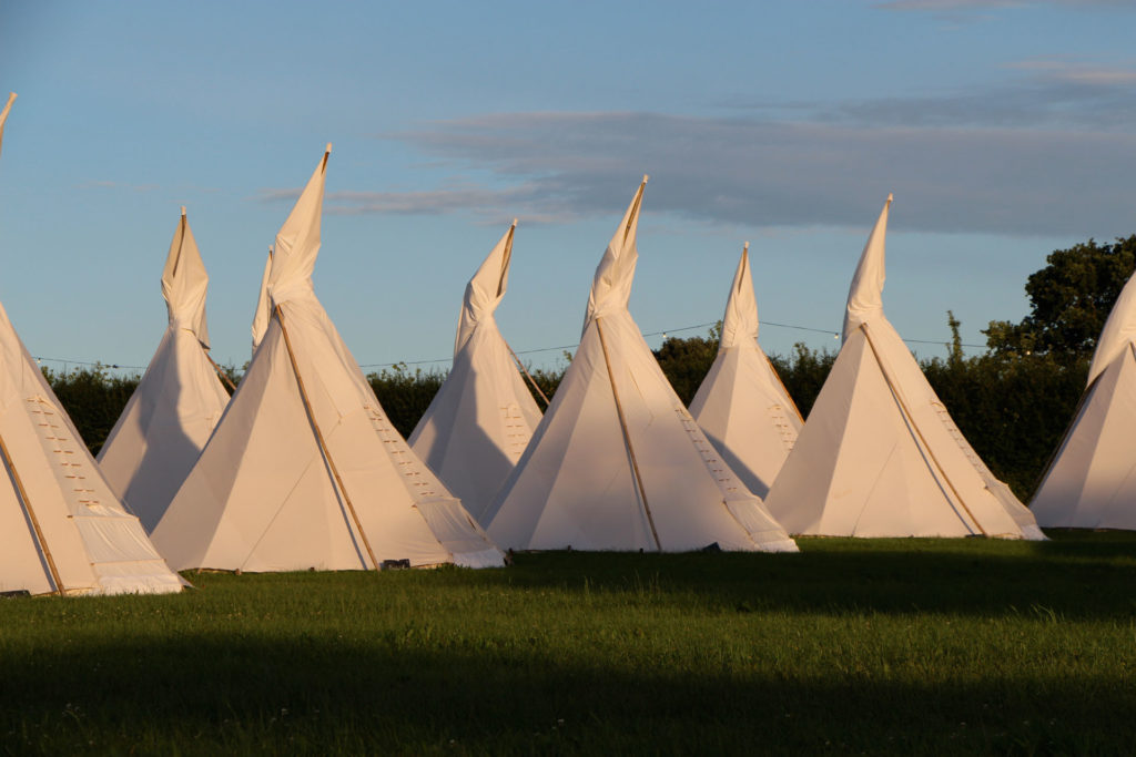 Majestic tipis at sunset - Pennard Orchard Boutique Camping for Glastonbury